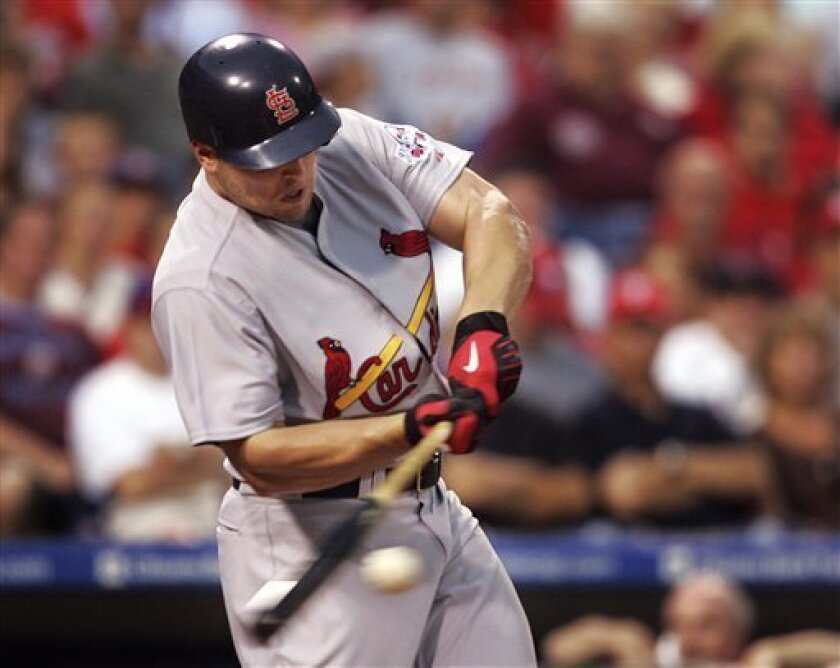 St. Louis Cardinals' Matt Holliday connects for a base hit off of Philadelphia Phillies starting pitcher J.A. Happ in the second inning of a baseball game Friday, July 24, 2009, in Philadelphia. (AP Photo/Tom Mihalek)
