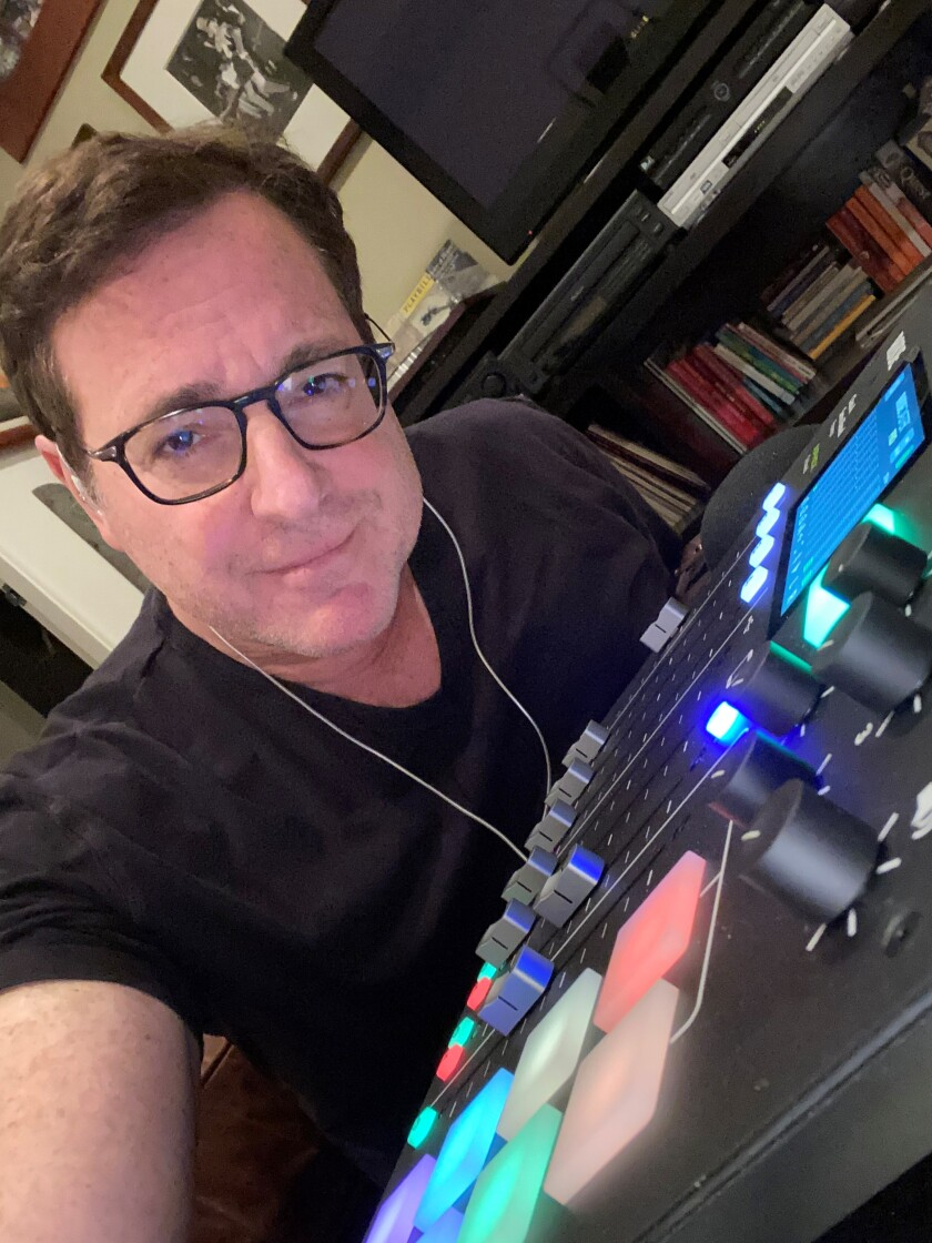 """Bob Saget records his new podcast, """"Bob Saget's Here for You,"""" from home."""