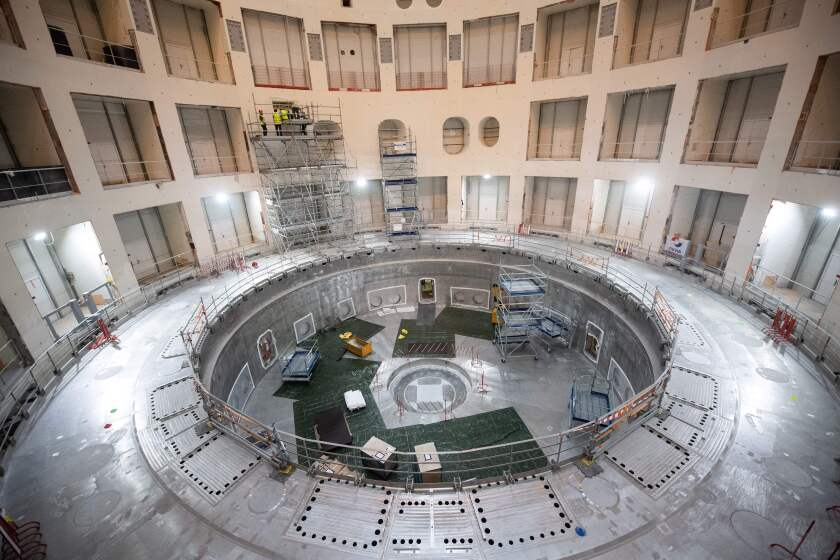 Technicians work on the tokamak building of the ITER project in France.