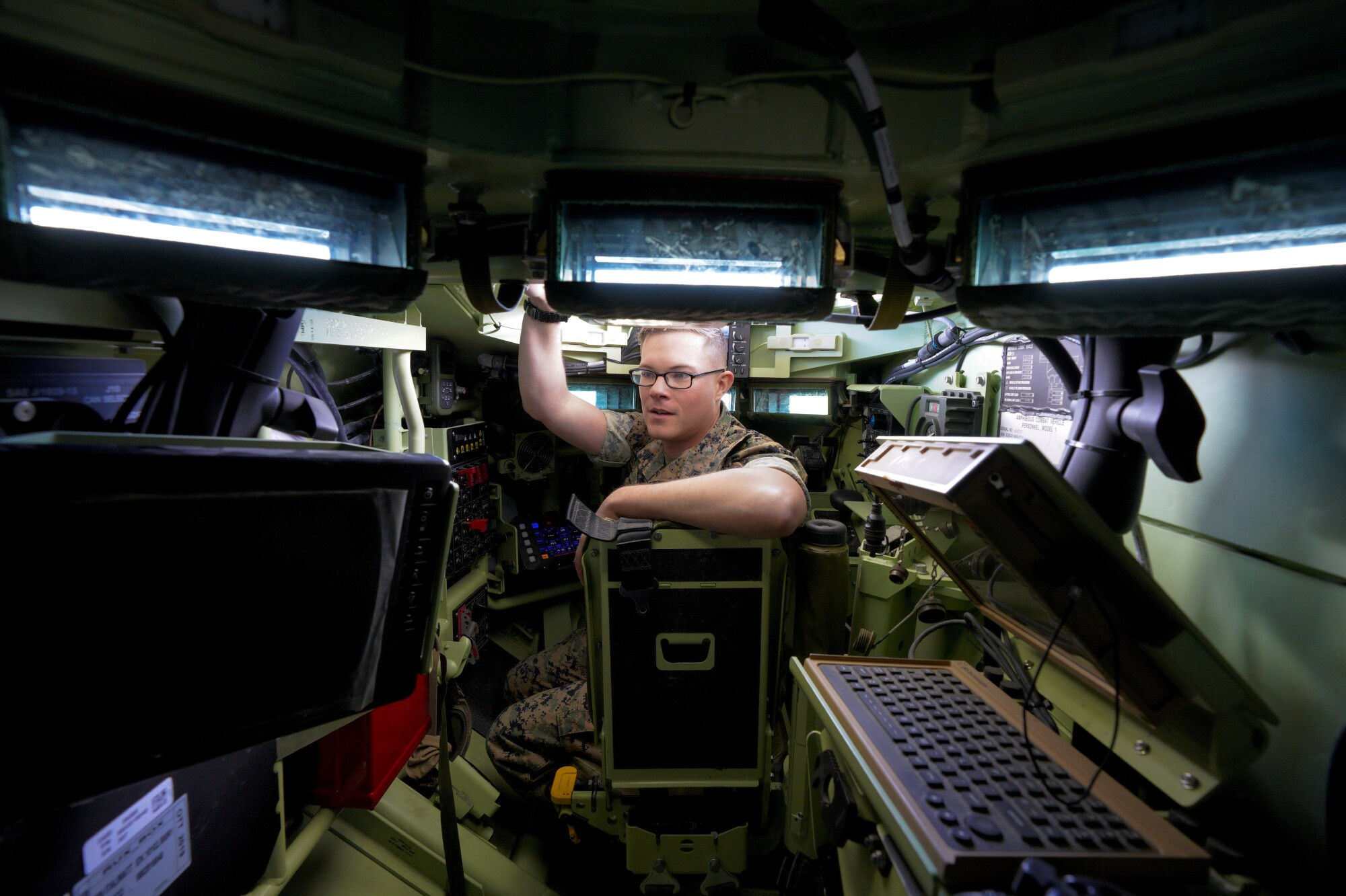 Sgt. Kyle Kohrs sits in the driver's seat of the Marine's new ACV (Amphibious Combat Vehicle)