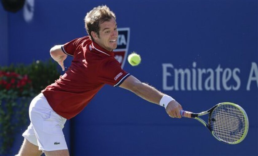 Richard Gasquet, of France, returns a shot to David Ferrer, of Spain, during the quarterfinals of the 2013 U.S. Open tennis tournament, Wednesday, Sept. 4, 2013, in New York. (AP Photo/Kathy Willens)