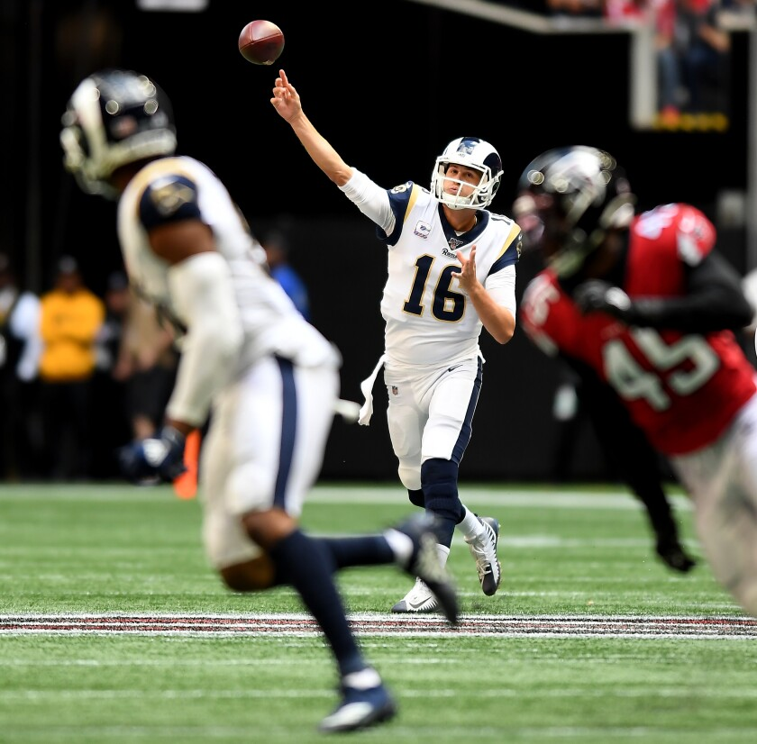 Rams quarterback Jared Goff looks to pass to receiver Robert Woods against the Atlanta Falcons.