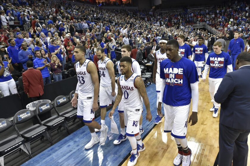 Kansas players and staff walk off the court after a regional final men's college basketball game against Villanova in the NCAA Tournament, Saturday, March 26, 2016, in Louisville, Ky. Villanova won 64-59.(AP Photo/John Flavell)