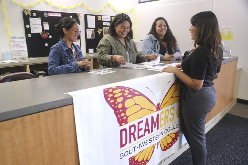 Alejandra Garcia, right, project specialist for the Southwestern College Dreamer Center, and student workers for the center, from left, Norma Vizcaino, Samantha Valdivia, and Kelly Alvarez, work on putting together information packets for undocumented students on Tuesday, Nov. 26, 2019 in Chula Vista, California.