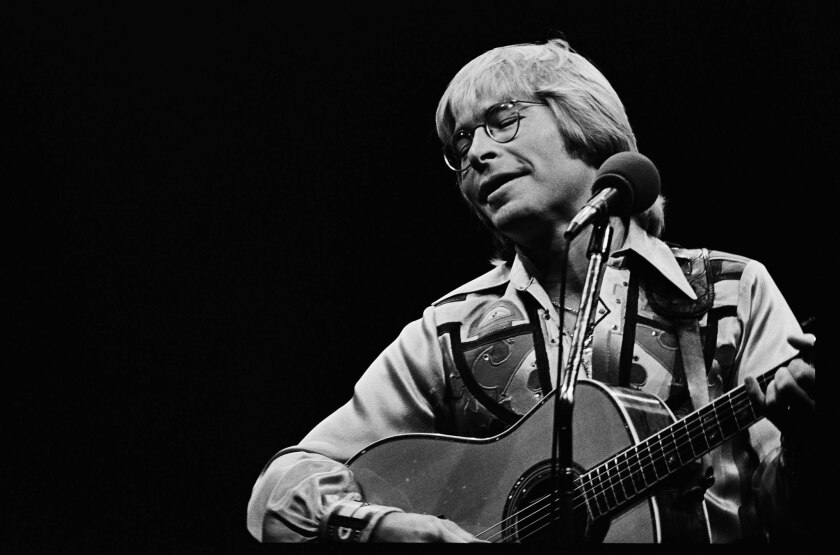 Caption: Celebration- John Denver, who sold out two conerts at the Inglewood Forum, showed added range and dimension in his music during performance Monday night.