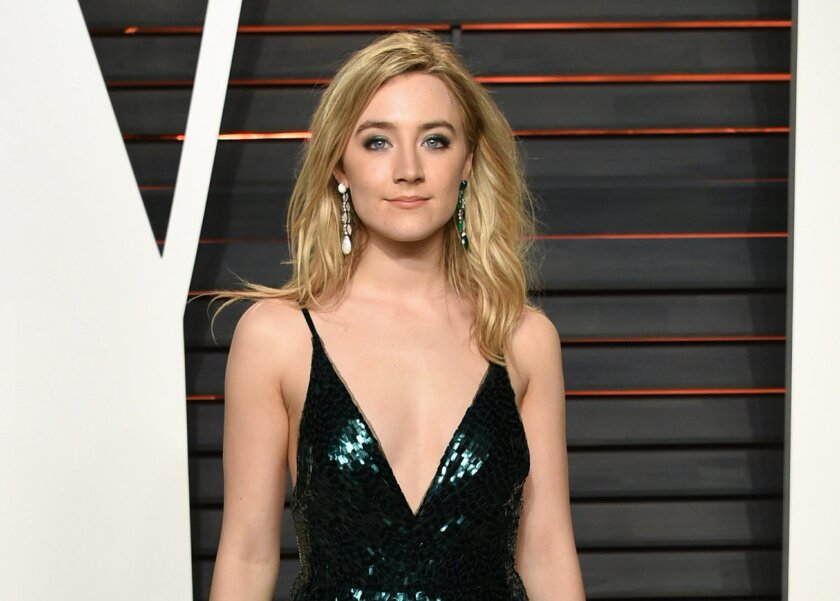 FILE - In this Feb. 28, 2016 file photo, actress Saoirse Ronan arrives at the Vanity Fair Oscar Party in Beverly Hills, Calif. Ronan will serve as a presenter at the Tony Awards in New York on June 12. (Photo by Evan Agostini/Invision/AP, File)