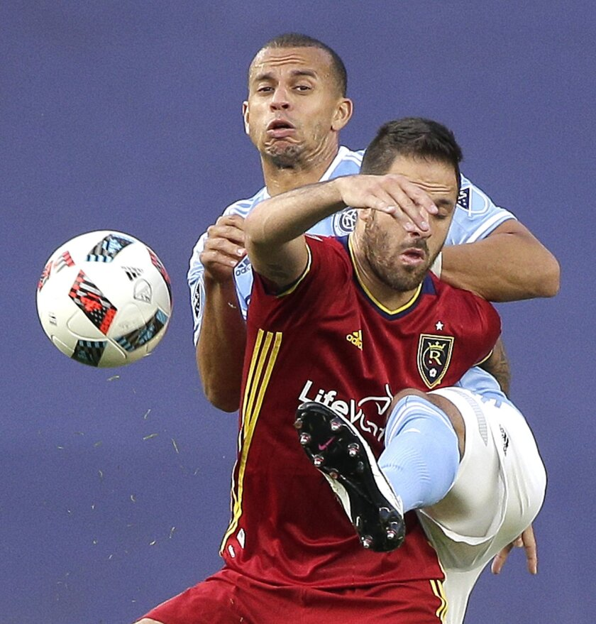New York City FC defender Jason Hernandez , left, vies for the ball against Real Salt Lake defender Chris Wingert (16) during the first half of an MLS soccer game, Thursday, June 2, 2016, in New York. (AP Photo/Julie Jacobson)