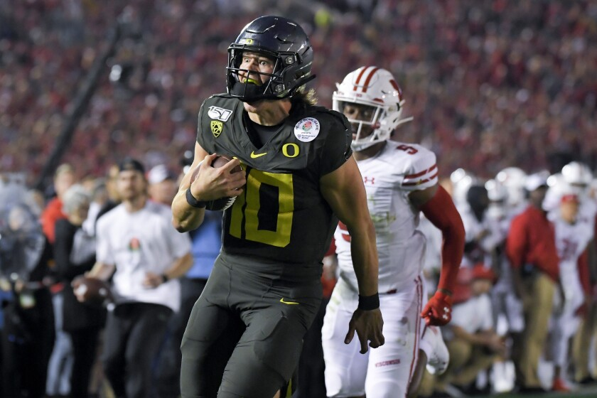 Oregon used turnovers and a 30-yard touchdown run by quarterback Justin Herbert to beat Wisconsin, 28-17, Wednesday in the Rose Bowl.