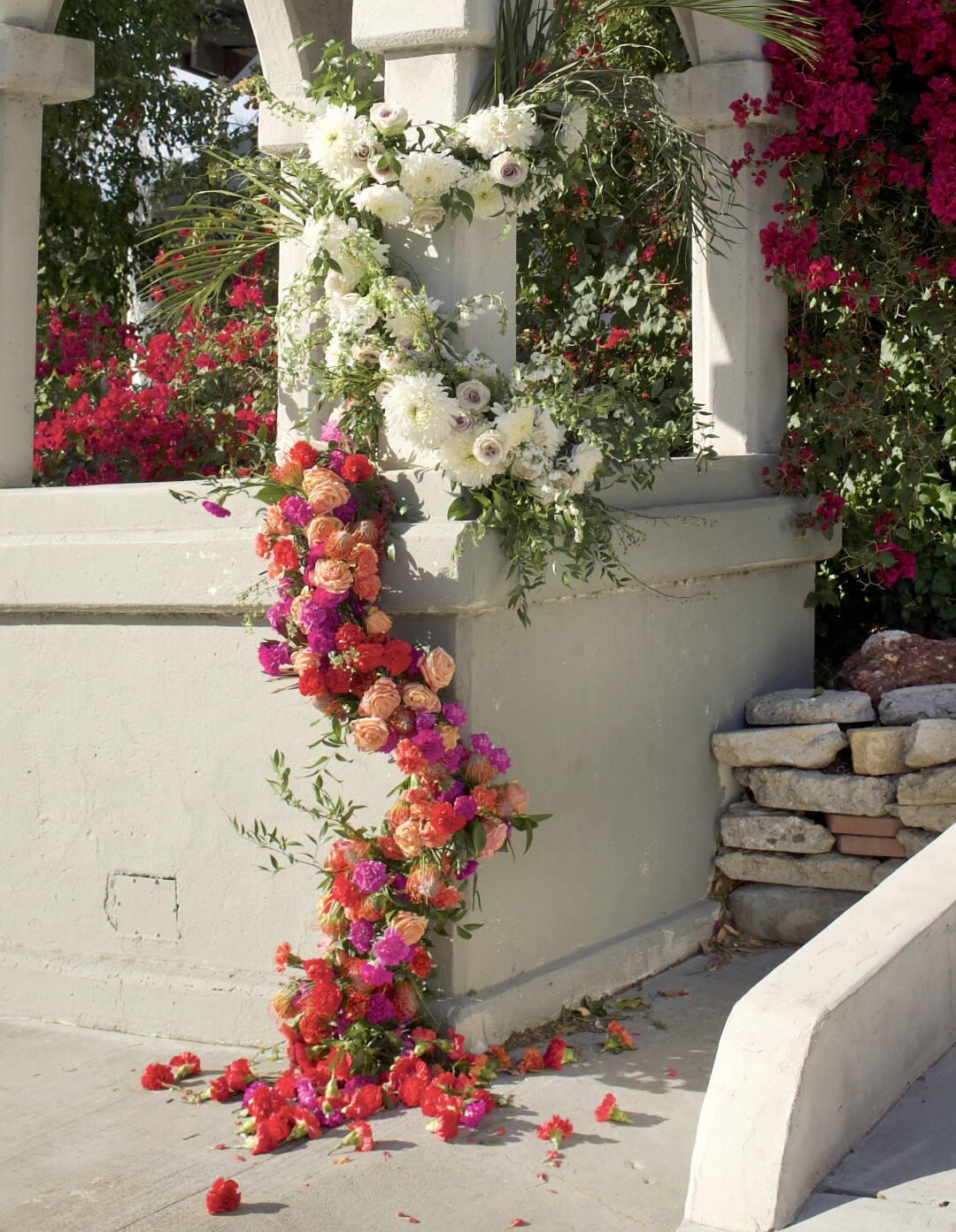 Photograph of a floral installation on the historic Shakespeare Bridge by Bia Yapp.