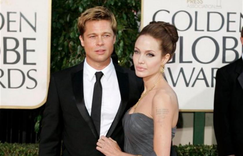 En esta foto del 15 de enero del 2007, Brad Pitt y Angelina Jolie llegan a la ceremonia de los Globos de oro en Beverly Hills, California. Angelina Jolie Pitt presentó una solicitud de divorcio de Brad Pitt, poniendo fin a uno de los romances más estelares y seguidos del mundo. (AP Foto/Mark J. Terrill, Archivo)