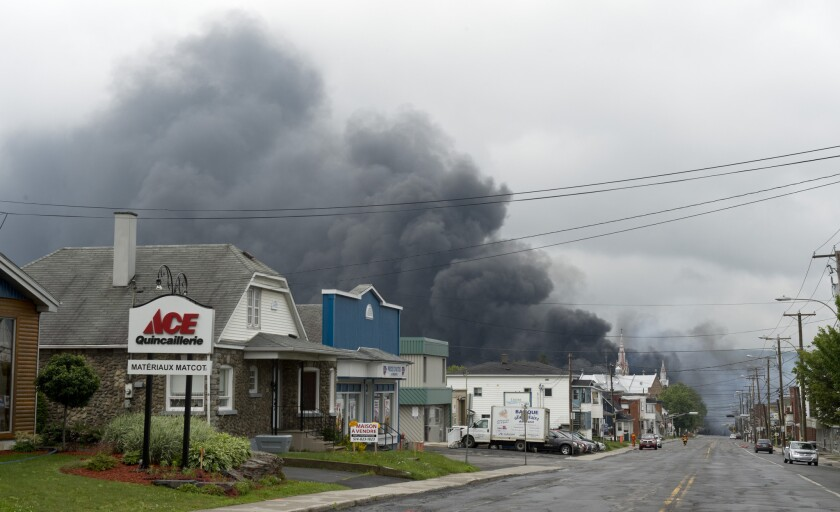 Smoke rises from railway cars that were carrying crude oil after derailing in downtown Lac Megantic, Quebec, Canada on Saturday.