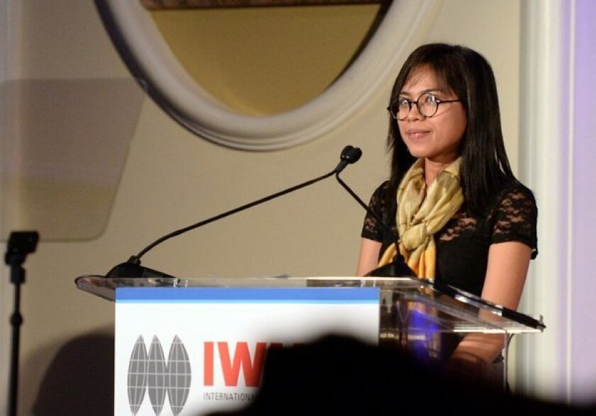 Cambodian journalist Bopha Phorn accepts her award from the International Women's Media Foundation. She was one of four honorees at the Beverly Hills event.