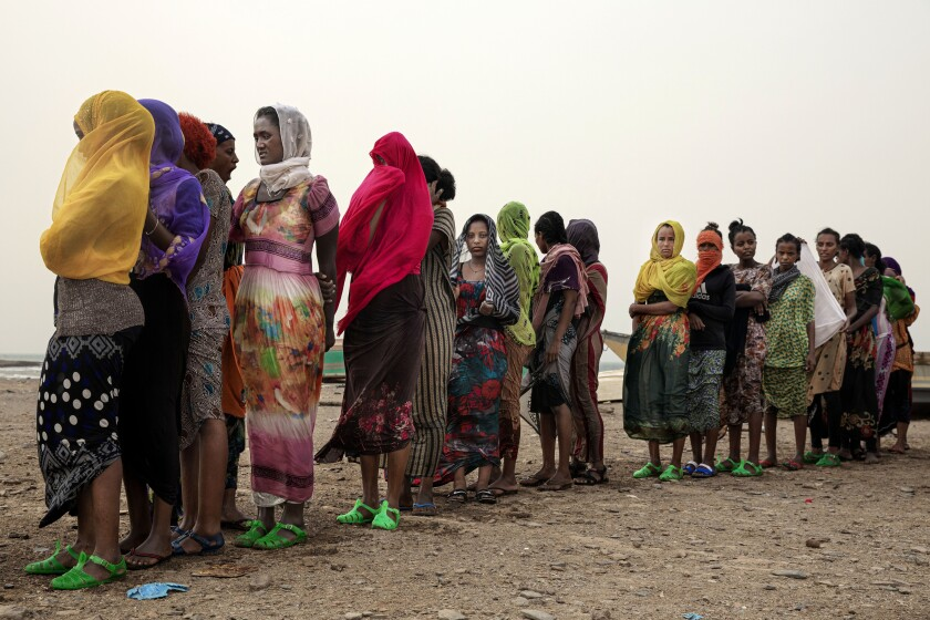 In this July 25, 2019 photo, Ethiopian Tigray migrants stand in line as they are counted by smugglers after arriving to the coastal village of Ras al-Ara from Djibouti, in Lahj, Yemen. According to the U.N.'s International Organization for Migration the number of women making the trip jumped from nearly 15,000 in 2018 to more than 22,000 in 2019. (AP Photo/Nariman El-Mofty)