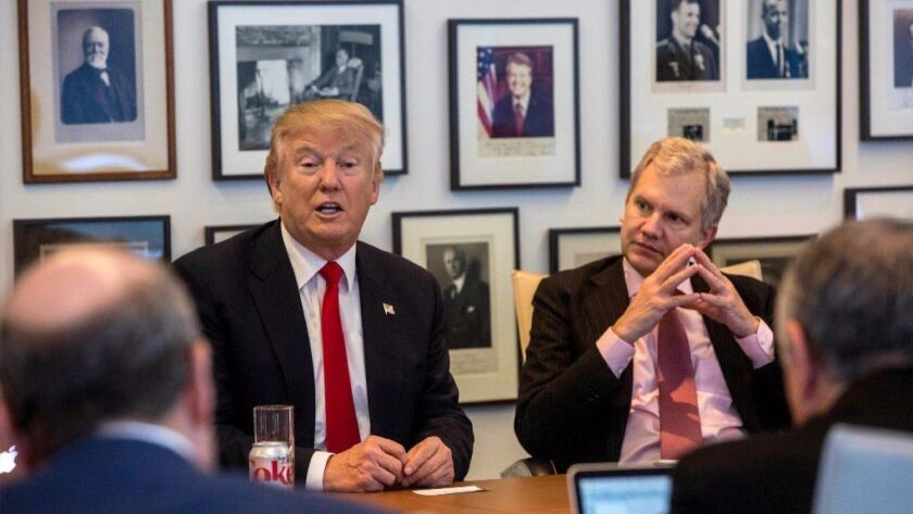 President-elect Donald Trump and New York Times Publisher Arthur Sulzberger Jr. appear during a meeting with editors and reporters at The New York Times building, Tuesday, Nov. 22, 2016, in New York.