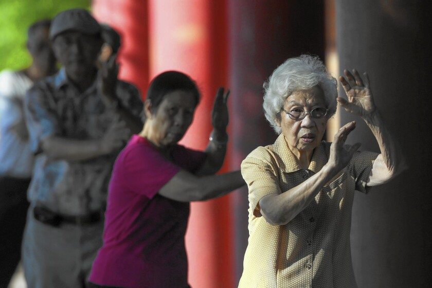 A group practices tai chi at Alpine Recreation Center in Los Angeles' Chinatown.