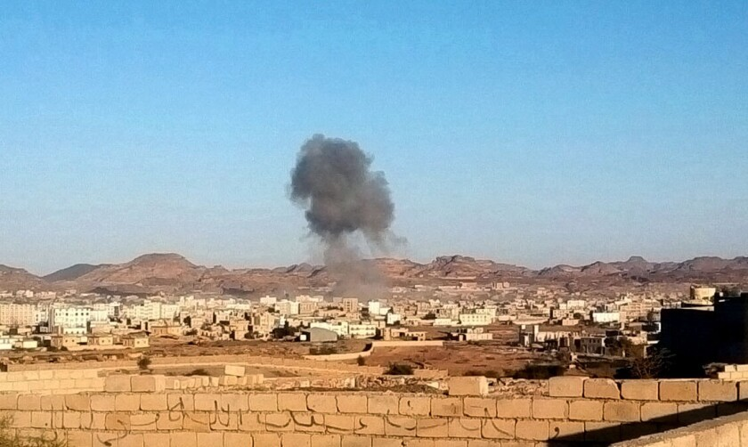 Smoke rises from the site of a car bomb explosion in Rada, Yemen, on Dec. 16.