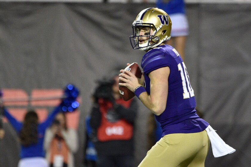Washington's Jacob Eason looks to pass during the Las Vegas Bowl on Dec. 21, 2019.