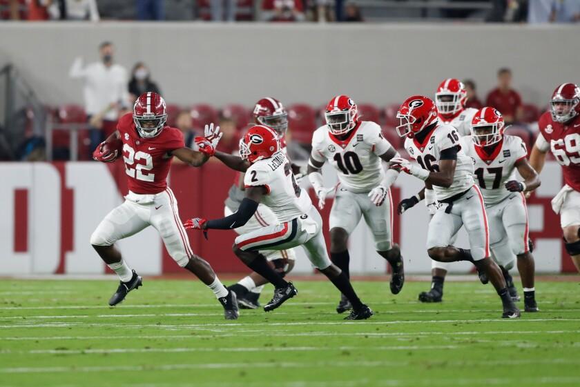 Alabama's Najee Harris breaks away from the Georgia defense on Oct. 17, 2020 in Tuscaloosa, Ala.