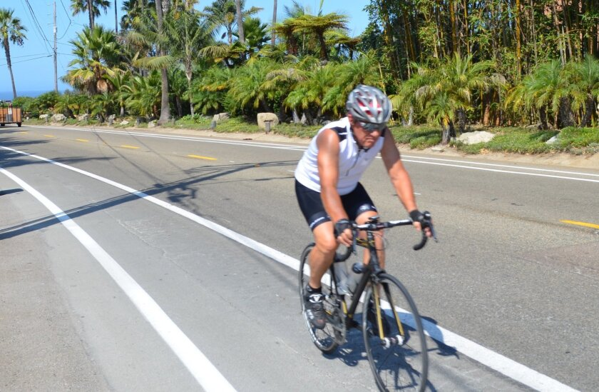 A bicyclist rides on La Costa Avenue, which was restriped with walking and biking in mind.