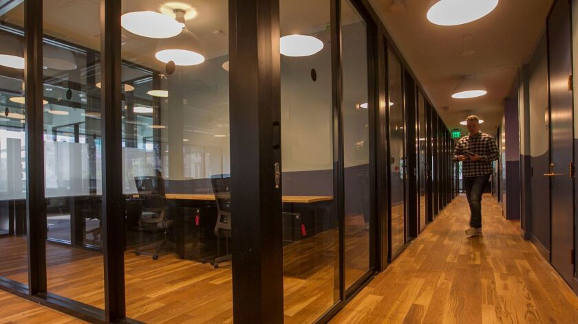 All WeWork private offices are enclosed in glass to encourage networking while muffling most sounds from neighbors.