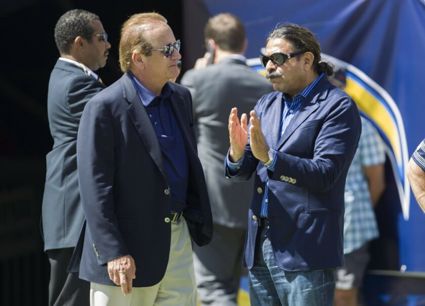 The San Diego Chargers vs. The Jacksonville Jaguars at Qualcomm Stadium. San Diego Chargers owner Dean Spanos (left) talks with Jacksonville Jaguars owner Shahid Khan prior to the game Sunday.