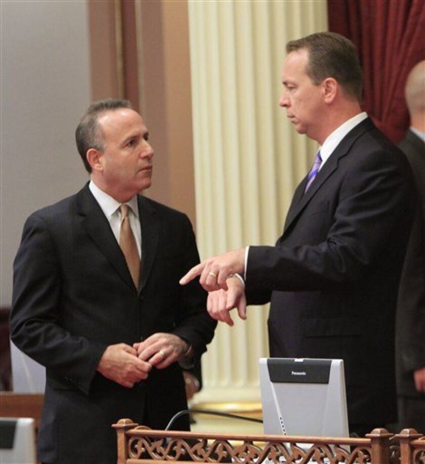 State Senate Pro Tem Darrell Steinberg, D-Sacramento, left, talks with Senate Minority Leader Dennis Hollingsworth, R-Murrieta, before lawmakers took up the state budget measure at the Capitol in Sacramento, Calif., Thursday, Oct. 7, 2010. Lawmakers are expected to vote on the spending plan, reached last week between Gov. Arnold Schwarzenegger and legislative leaders, to close a $19 billion deficit and end the longest budget impasse in the state's history.(AP Photo/Rich Pedroncelli)