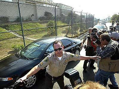 Santa Barbara Sherriff attempts to keep back crowds
