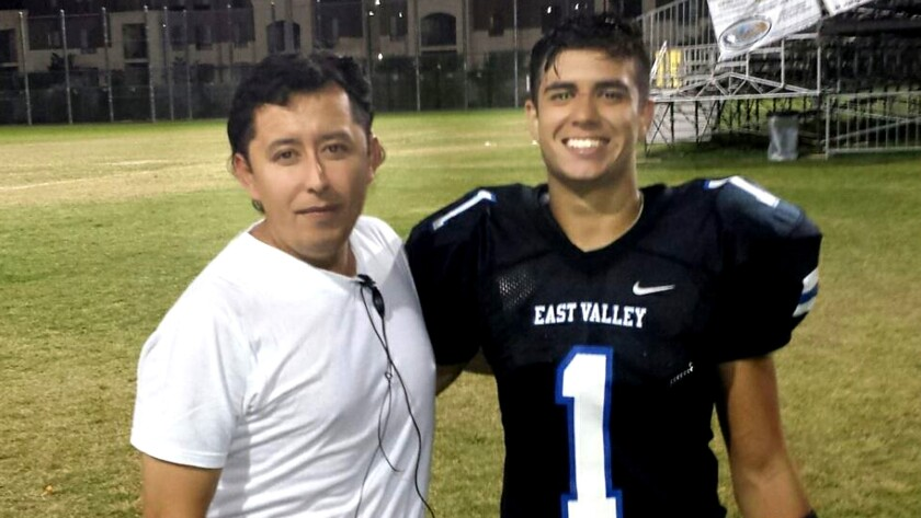 East Valley running back Joseph Hernandez (1) and his father, Adner Herrera.