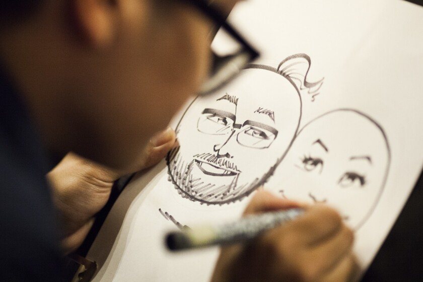 Caricature artist Ramon Sosongco Jr. draws emoji faces of attendees at the Emojicon launch party Friday, 4 Nov. 2016 at Covo a co-working space in San Francisco, CA, USA. (Peter DaSilva/For The Times)