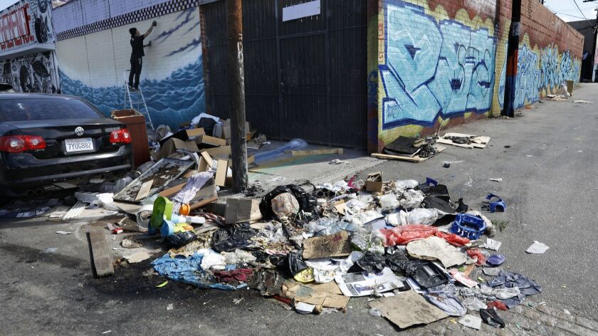 LOS ANGELES, CA-OCTOBER 11, 2018: A pile of trash sits uncollected on Santee St. in between 18th St
