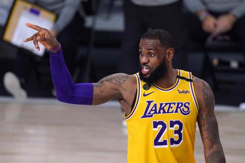 Lakers forward LeBron James directs teammates during a game against the Rockets on Sept. 10, 2020.