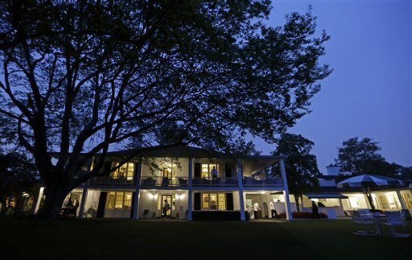 The Augusta National clubhouse is seen in the early hours before the first round of the Masters golf tournament Thursday, April 11, 2013, in Augusta, Ga. (AP Photo/Darron Cummings)