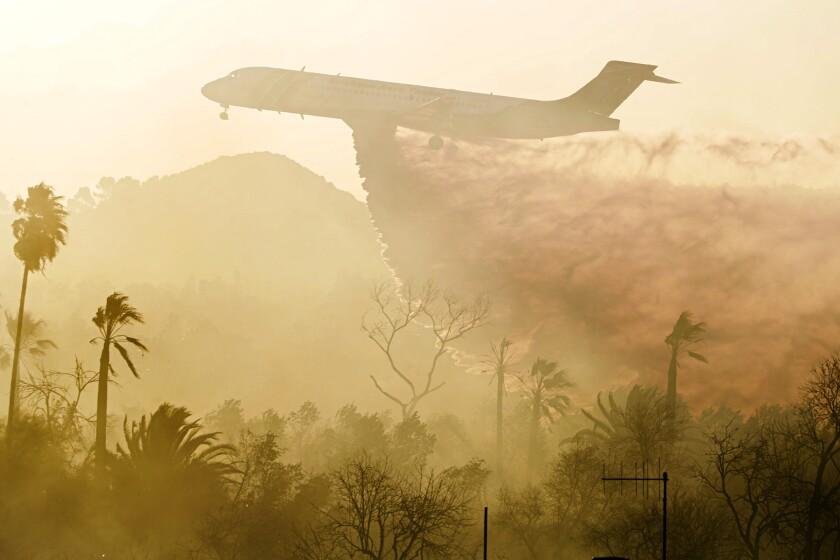 A plane drops retardant on the 46 fire in Jurupa Valley.