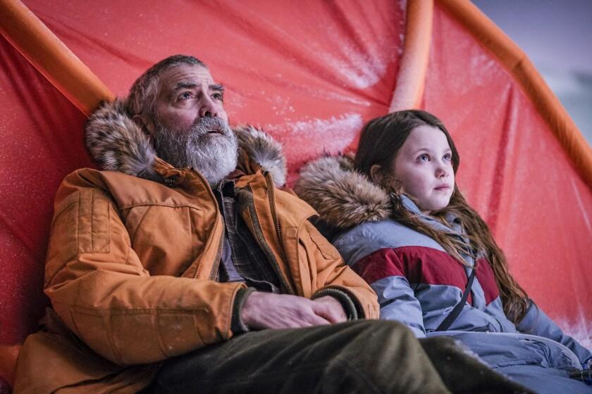 """George Clooney and Caoilinn Springall look skyward in the movie """"The Midnight Sky."""""""
