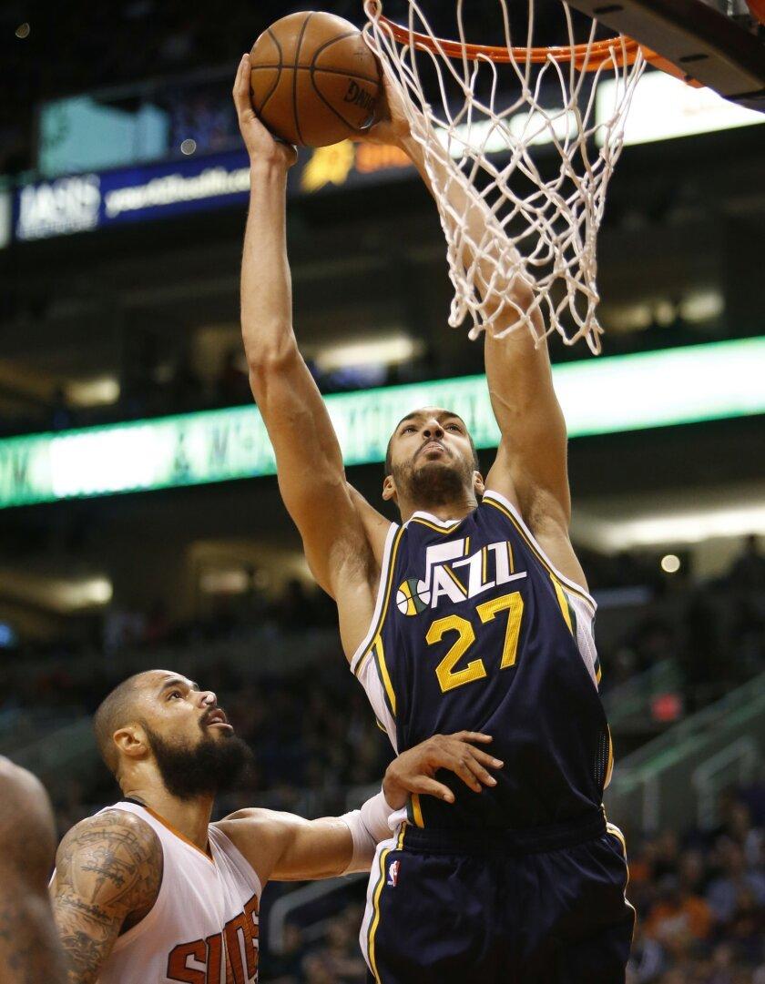 Utah Jazz center Rudy Gobert (27) shoots over Phoenix Suns center Tyson Chandler in the second quarter during an NBA basketball game, Saturday, Feb. 6, 2016, in Phoenix. (AP Photo/Rick Scuteri)