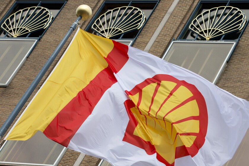 A flag bearing the logo of Royal Dutch Shell flies outside the company's main office in The Hague, Netherlands, on April 7, 2014.