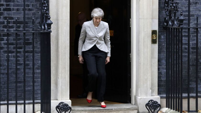 Britain's Prime Minister Theresa May arrives to make a statement outside 10 Downing Street, London,