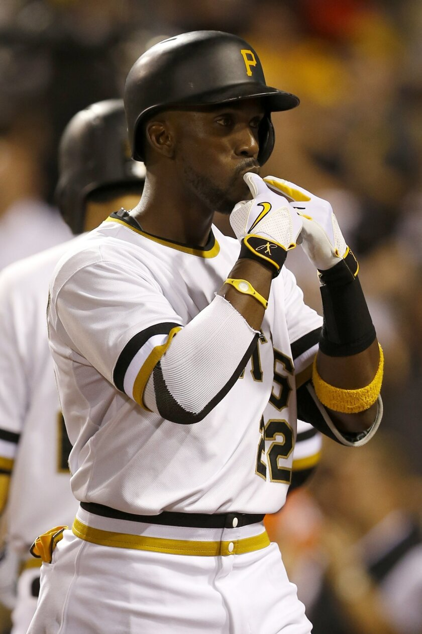 Pittsburgh Pirates' Andrew McCutchen gestures as he walks to the dugout after hitting a solo home run in the sixth inning of a baseball game against the San Francisco Giants, Sunday, Aug. 23, 2015, in Pittsburgh. (AP Photo/Keith Srakocic)