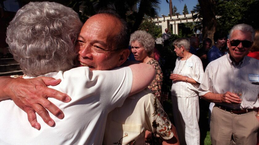 Pasadena civic leader Al Lowe, 73, receives a hug from former Pasadena Mayor Katie Nack at a farewell celebration for Lowe and his wife, Rose Marie, at the Tournament House in Pasadena Sunday afternoon.