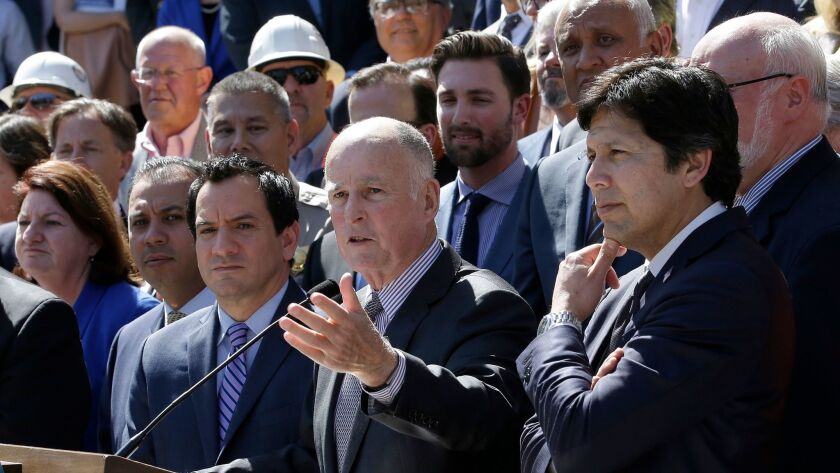 Gov. Jerry Brown answers a question last month about the $52 billion plan to fix California roads. B