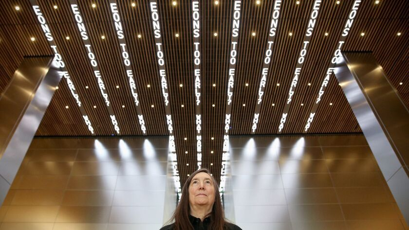 "Artist Jenny Holzer, photographed in October beneath her digital art installation ""For Philadelphia"" at the Comcast Technology Center. Her project for Desert X has been put on hold."
