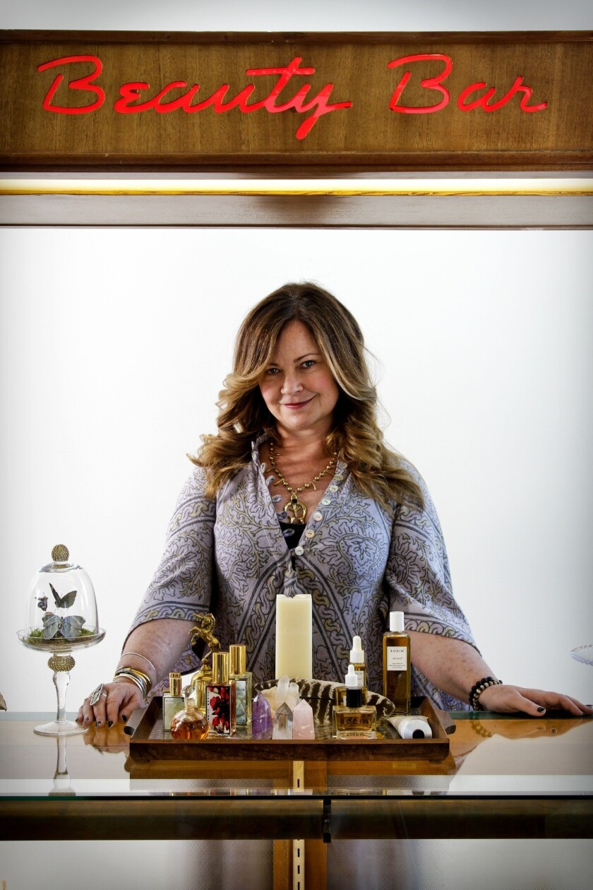 Jennifer Nicholson, wearing a GoldDust dress and a necklace by L.A.-based jeweler Jessica Seaton, is behind the Beauty Bar at Pearl Drop, her new shop on Lincoln Boulevard in Venice.