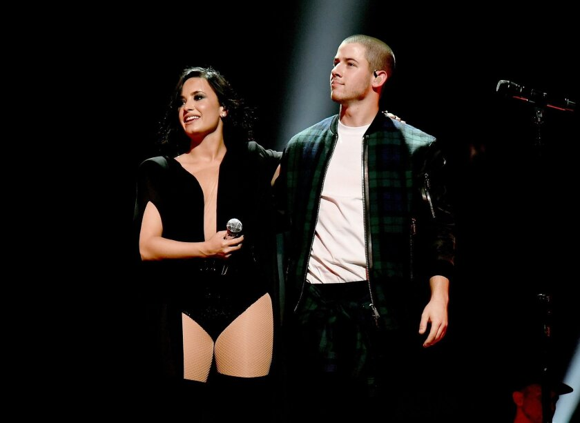 Demi Lovato and Nick Jonas are on tour together.