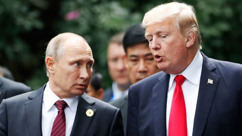 Russian President Vladimir Putin, left, and U.S. President Trump confer during the Asia-Pacific Economic Cooperation leaders' summit in Vietnam in November.