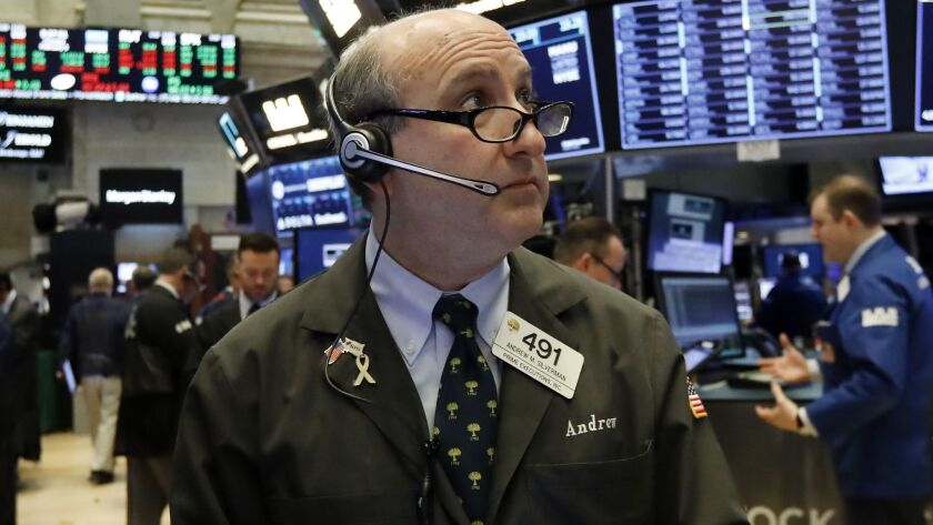 Trader Andrew Silverman works on the floor of the New York Stock Exchange.