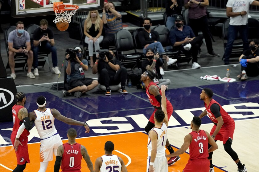 Phoenix Suns guard Devin Booker (1) makes the game winning free throw against the Portland Trail Blazers during the second half of an NBA basketball game, Thursday, May 13, 2021, in Phoenix. The Suns won 118-117. (AP Photo/Matt York)