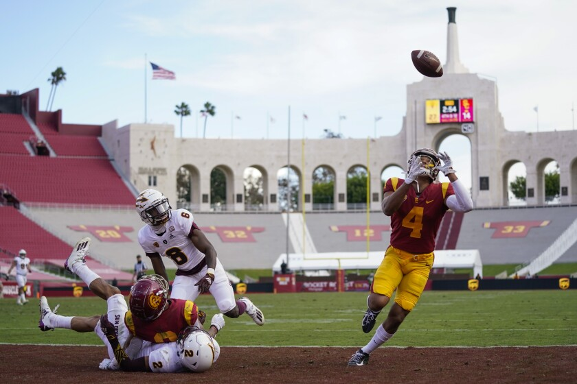 USC wide receiver Bru McCoy catches a deflected pass in the end zone for a touchdown in the Trojans' 28-27 win.