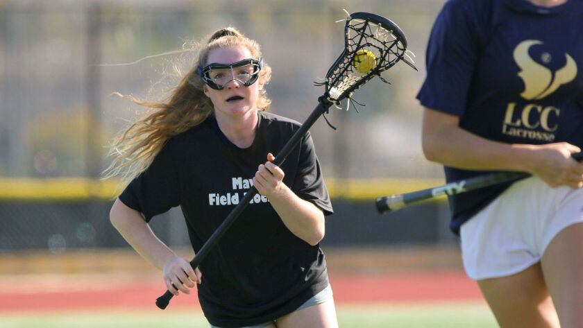 La Costa Canyon High lacrosse player Sierra Lizerbram sprints across the field with teammates during practice.