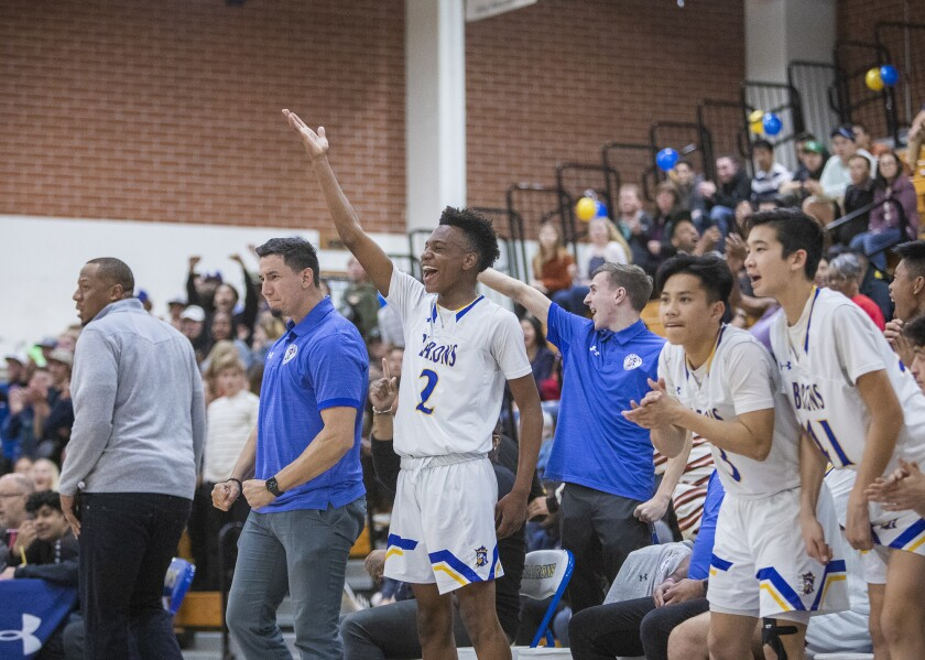 Fountain Valley's bench celebrates as the host Barons defeat Temple City in the second round of the CIF Southern Section Division 3A playoffs on Friday.