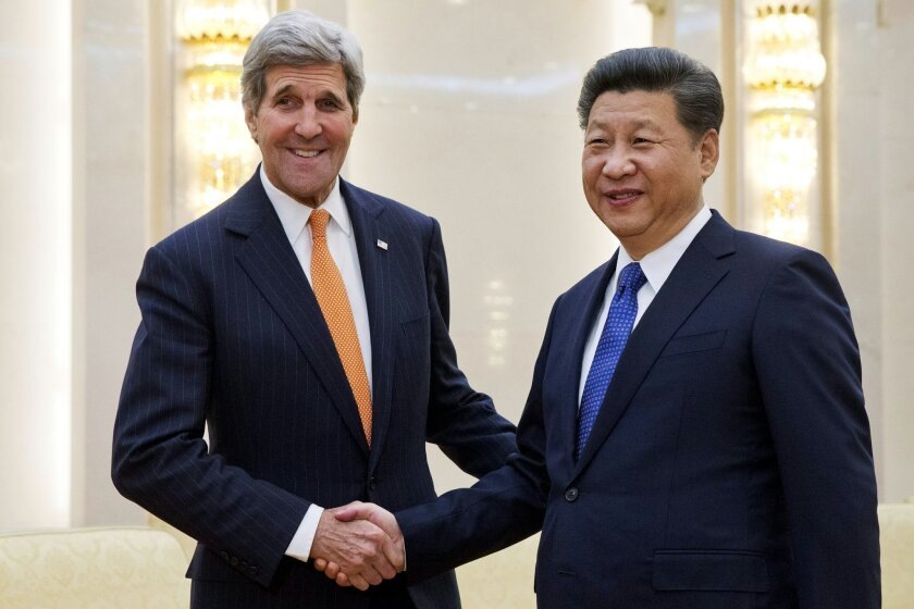 In this Jan, 27, 2016, file photo, U.S. Secretary of State John Kerry, left, poses with Chinese President Xi Jinping prior to their meeting at the Great Hall of the People in Beijing. North Korean nuclear and rocket tests are drawing quick responses from the U.S. that will upset a supposed partner